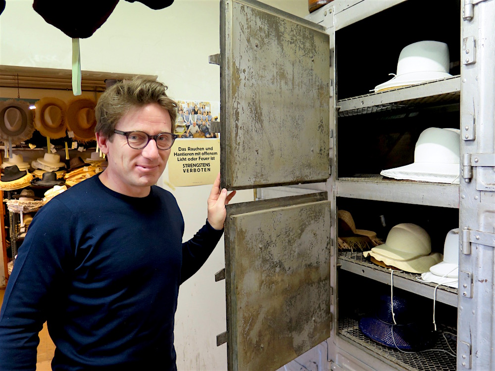 "Klaus Mühlbauer in front of the ""hat oven"" at the Mühlbauer atelier in central Vienna (photo by ©MRNY)"